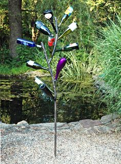 The Southern tradition of Bottle Trees dates back to Africa, where it was thought blue bottles especially would capture evil spirits.