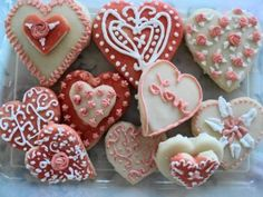 Valentine sugar cookies decorated with Royal Icing. Recipe for Royal Icing and tutorial included