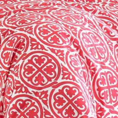 Morgan Duvet Cover Set by Poppy & Fritz - A bold red and white medallion print on this Poppy & Fritz Morgan Cotton Duvet Cover Set gets a nautical flair when paired with a navy and white awning...