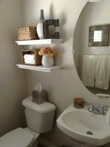 decorating small bathroom space with shelves and mirrors