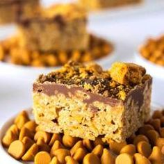 These Butterfinger Scotcheroos are chewy sticky and so chocolatey. The addition of crushed Butterfingers makes them truly irresistible! Grab the kids because theyll love making these no-bake Chocolate Scotcheroos recipe with you! Brownie Desserts, Oreo Dessert, Mini Desserts, Types Of Desserts, Just Desserts, Delicious Desserts, Dessert Bars, Top Recipes, Best Dessert Recipes