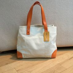 "Summer canvas tote bag Cream canvas tote bag with orange vinyl trim.         11"" deep. 14"" long and 5"" wide Straw Studio Bags Totes"