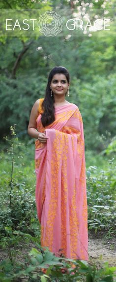 Featuring a coral pure georgette saree from EAST & GRACE with orange gingko leaf rows on pallu and skirt of the saree. It comes with an unstitched orange sleeveless blouse. Visit www.eastandgrace.com. Price: RS.13,000.