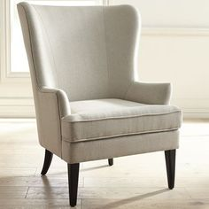 A graceful wing chair in search of a cozy corner, our hand-upholstered Asher is all about classic lines, capped midcentury modern legs and gorgeous color—and is ready to hold draped throws and stacked pillows. Why not invite a small table to hold tea and books?
