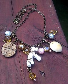 'Beachcomber's Treasure Necklace: SOLD for $25.00.  Made from beach pepples, coral and sea shells I found on a Florida beach. One of a kind Shell Jewelry. Perfect for any beach lover!