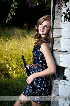I love her Dress and Clarinet <3 :] Pretty and chic! :]                                                                                                                                                     More