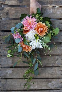 A cascading bouquet of seasonal flowers #cascadingbouquet #weddingflowers