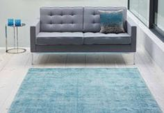 distressed two-tone effect rug looks the part in this interior scheme