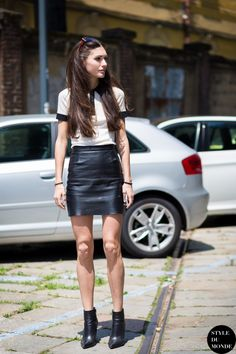 pointed boots with leather mini skirt and collared top