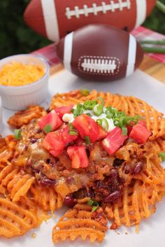 Waffle Fries Nachos made with chili, tomatoes, salsa and cheese. Perfect for game day or a super bowl party! See the full recipe...