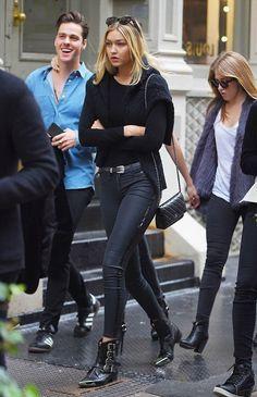 Click here to see best black wax coated skinny jeans like Gigi Hadid wears:  http://www.slant.co/topics/4615/~mid-rise-black-wax-coated-skinny-jeans
