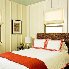 White trimwork and a pop of color on the bed.