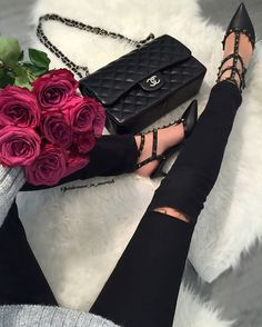 Red roses, Valentino shoes and Chanel bag for the lady. #fromwhereistand #fashionblogger #skinnyjeans #blackonblack #chanel #chanelbag #valentino #valentinoshoes #rockstudpumps #pumps #fabfashionfix