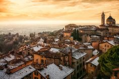 View of the upper city of Bergamo in a winter sunset.