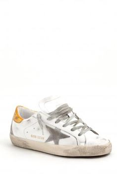 Golden Goose footwear - sneakers super star white gold/cream sole - white leather sneakers from Golden Goose, golden leather band behind the heel, white sponge and leather interiors, laced closure, cream rubber sole. Insole heeled 2,5 cm. Golden Goose collection Autumn Winter 2013-2014. Golden Goose deluxe brand Venezia. Made in Italy.