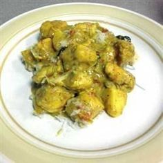 Morsels of chicken breast are slow-cooked in a creamy coconut curry with potatoes and red bell pepper. Raisins and flaked coconut add texture and sweetness to this rich dish.