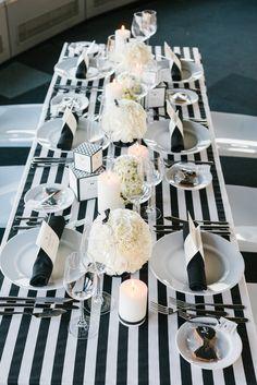 Modern monochrome table setting with striped linen  Photography: www.jenniferhejna.com