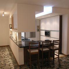 Cocina integrada en remodelación de apartamento en Altamira