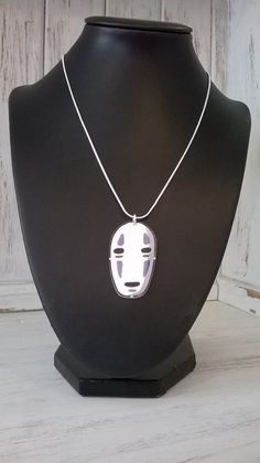 No Face handmade pendant on an 18 silver by thomaschadwickdesign, £10.00