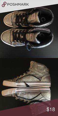 High top shoes by Guess These are a pair of high top sparkly/glitter silver shoes. Worn once and in perfect condition. Very comfortable. If you have any questions please ask! Guess Shoes Sneakers