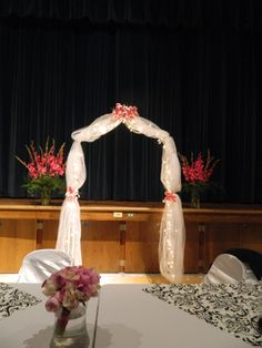 The wedding arch was decorated for a beautiful wedding ceremony.