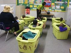 Tubs are Sensory Strategies to provide boundaries for Moderate ASD class during group time activities.