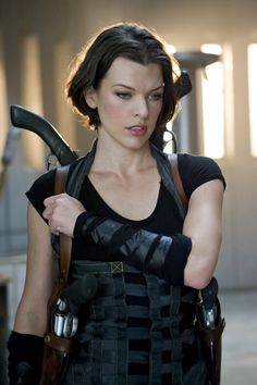 Milla Jovovich in Resident Evil movies inspires me to want to kick butt :)
