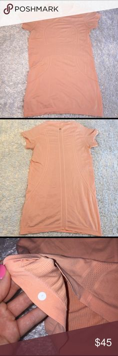 Lululemon Swiftly Tech Top Size 6, excellent condition! Still has rip tag. Color is peach! Feel free to ask any questions! lululemon athletica Tops