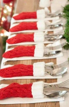 Christmas table decoration: Mini stockings to hold silverware! So cute!!!