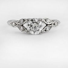 Platinum replica art deco engagement ring setting has six round diamonds,.08 carat total H color and VS2-SI1 clarity,bead set in the center of a geometric cluster marquise shapes.
