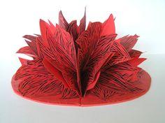 ArtistHelen Malone TitleBloom Year2013 MediumLinocuts on Canson paper SupportArtists Book Height26 cm closed Width14 cm closed Depth2 cm    A sculptural interpretation of a flower in Bloom.