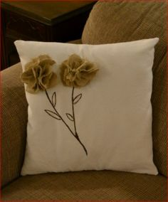 Pillow with burlap flowers. An easy DIY. I think I would like more clustered flowers and no stems. :)