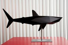 Amazing black polygonal shark sculpture.