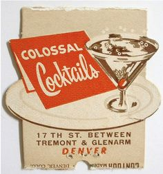 """Either the sign and the plate are also """"colossal"""" or that martini is a normal-sized cocktail."""