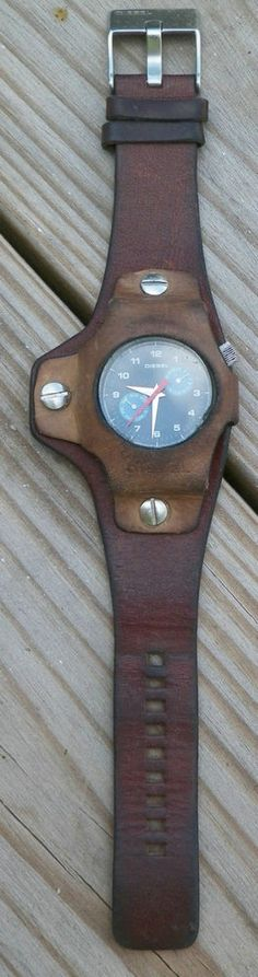Vintage, hard to find W/ Diesel leather band, water resistant 10 Bar, 250408 Mens Stainless Steel. Does have 2 chipped places on edge of face as noted above. New battery installed early 2016.