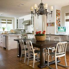 adjacent to the kitchen is a breakfast area + floor to ceiling closed door cabinets + mail slots + message board