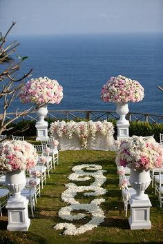 floral wedding aisle at the ocean