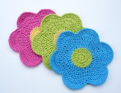 Whiskers & Wool: Flower Power Dishcloth - Free Pattern. Use perle cotton and small hook for appliqué motif for girls' clothes or dolls.
