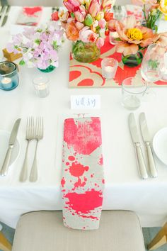 paint-splattered napkins, photo by Kate Robinson Photography http://ruffledblog.com/whimsical-australian-wedding-with-bright-colors #weddingideas #placesetting
