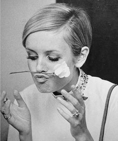 Twiggy. Lip grabbing a flower.