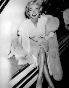 1950's candid photograph of screen Icon smiling and wearing her mink stole