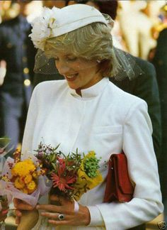 Princess Diana.  I LOVED this outfit on her & the winter white color!  I LOVED winter white in the 80s and still do :)