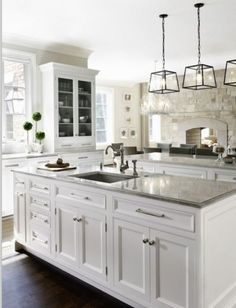 white kitchen with 3 pendant lights