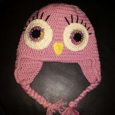 Crochet owlhat with flower on the top