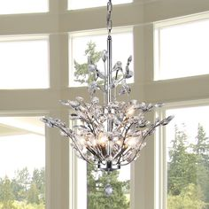 Add some elegance and class with this stylish and functional Anastasia Leaf chandelier. This dynamic lighting element features generous crystals to catch the light for an impressive display that is perfect for your home.