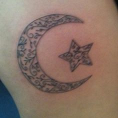 Moon and star tattoo.