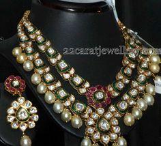 http://www.22caratjewellery.com/2015/06/green-enamel-work-kundan-set.html