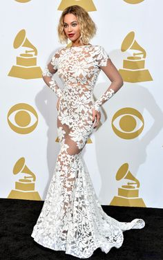 Beyonce in a GORGEOUS Michael Costello floor length gown at the 2014 Grammys -  She looks effing amazing this dress is fabulous, her hair looks fabulous and her makeup is perfect. Loving every bit of this