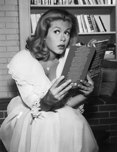 """Elizabeth Montgomery readingThe Omni-Directional Three-Dimensional Vectoring Paper Printed Omnibus for Bewitched Analysis a.k.a. The Bewitched History Book. By David L. Pierce. """"Within these pages you will learn everything about America's favorite witch, Samantha Stephens, her dreary mortal husband, Durwood, er, Darrin, and the grand host of witches, warlocks, and marvelous mortals who accompanied them on their journey as newlyweds to the parents of a little witch and warlock of their ..."""