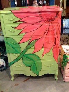 Love the flower on this dresser makeover! Thought of my daughter when I saw this, she would do this for her daughters room!